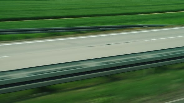 Thumbnail for Quickly Go By Motorway, Which Passes Through Green Fields