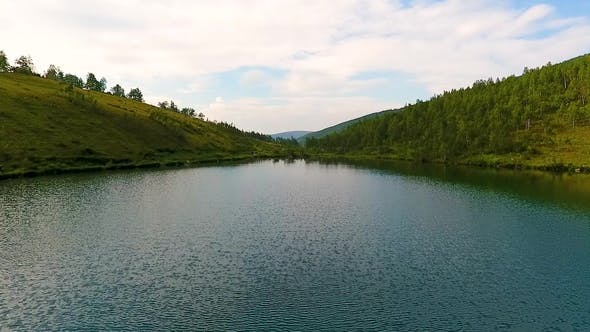 Thumbnail for Aerial View of Ivanovskie Lakes, Waterfall, Glacier after Rain and before Sunset