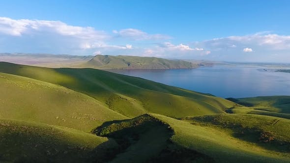 Thumbnail for Aerial View of the Green Hills, Cloudy Sky and the Yenisei River