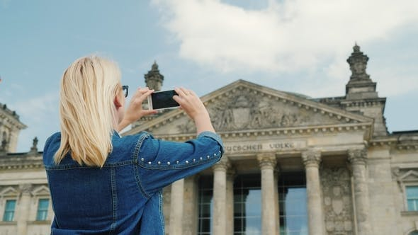Thumbnail for A Woman Tourist Takes Pictures of the Building of the Bundestag in Berlin. Tourism in Germany and