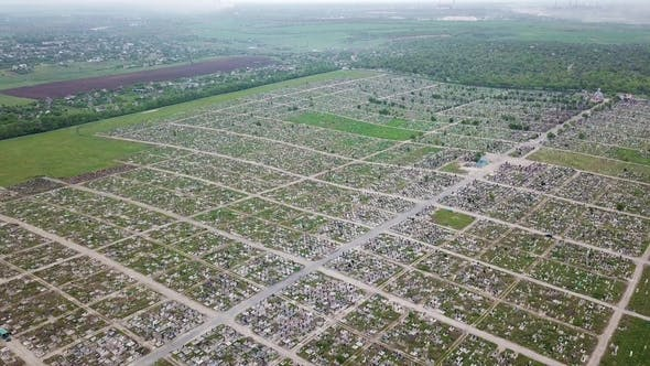 Thumbnail for An Aerial Over a Vast Cemetery of Headstones Honors Veterans