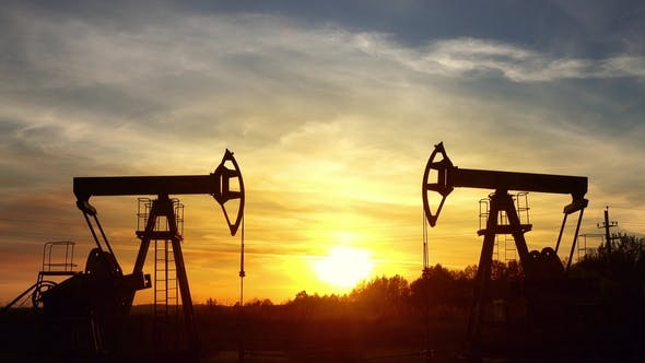 Thumbnail for Working Oil Pumps Silhouette Against Sunset