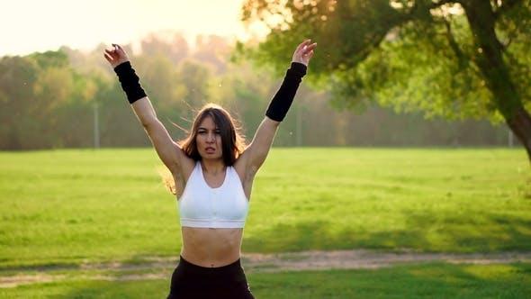 Thumbnail for Female Fitness Instructor Doing Jumping Jacks Exercising in Green Park