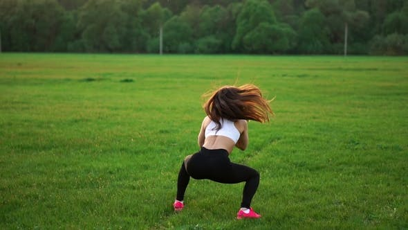 Thumbnail for Young Muscular Fitness Woman Doing Squats Exercise in the Nature