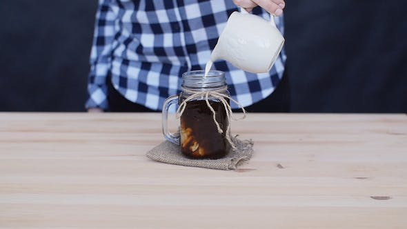 Cream Is Poured Into a Coffee Cocktail
