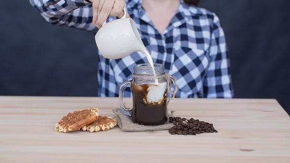 Thumbnail for Cream Is Poured Into a Coffee Cocktail