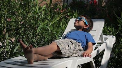 Boy on the Beach with Sunglasses