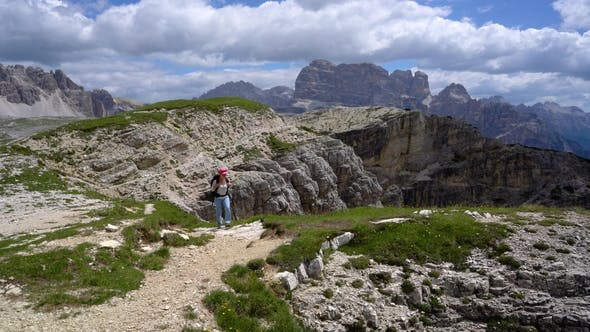 Thumbnail for Hiker Woman Standing Up Achieving the Top Dolomites Alps