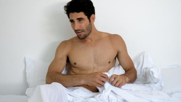 Thumbnail for Dude Dressing in Bed