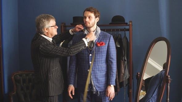 Thumbnail for Tailor with Client in Atelier. Sewing Custom Made Suit.