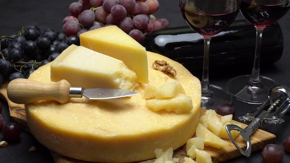 Thumbnail for Video Whole Round Head of Parmesan or Parmigiano Hard Cheese, Grapes and Wine