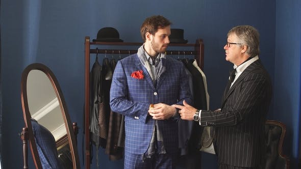 Thumbnail for Tailor with Client in Atelier. Sewing Custom Made Suit