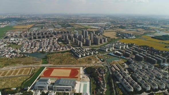 Thumbnail for Aerial Over Suburb, Village, Fields and Rivers on Sunny Day