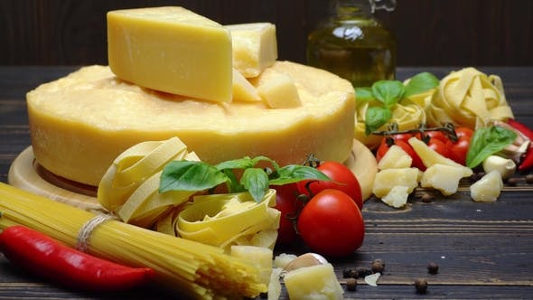 Cover Image for Video of Traditional Italian Food - Parmesan Cheese, Pasta, Tomato and Olive Oil