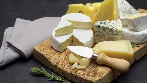 Cover Image for Video of Various Types of Cheese - Parmesan, Brie, Roquefort
