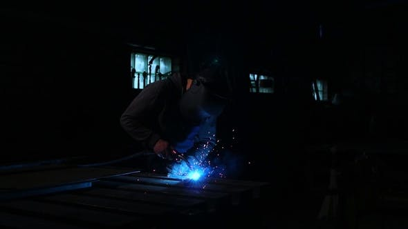 Thumbnail for Industrial Worker at the Factory Welding, Worker Welding at Industrial Factory.