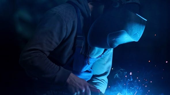 Cover Image for Industrial Worker Welding at the Factory