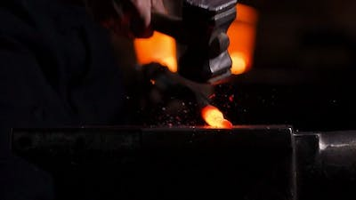 Getting out Hot Metal of the Furnace to Make a Sword