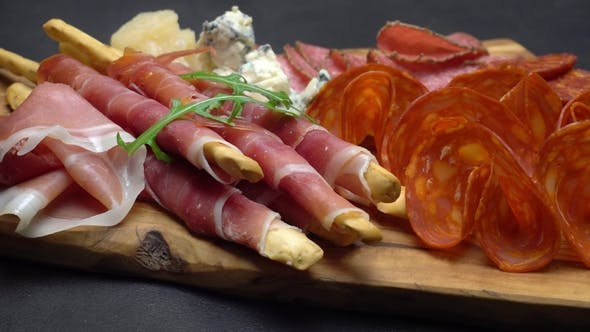 Cover Image for Video of Italian Meat Plate - Sliced Prosciutto, Sausage, Grissini and Parmesan