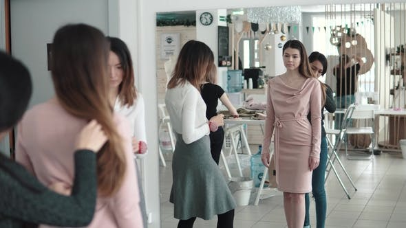 Thumbnail for Employees Atelie Trying on Clothes on the Client. a Group of Fashion Designers Work Together