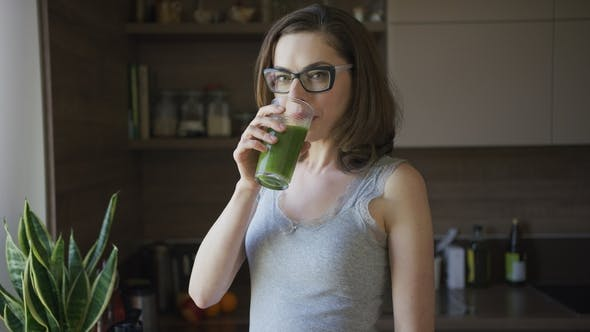 Thumbnail for Young Woman Drinking Smoothie at Home