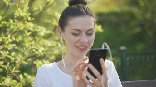 Enthusiastic Woman Texting on Smartphone