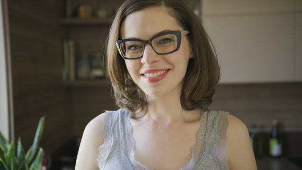 Thumbnail for Smiling Beautiful Woman in Eyeglasses at Home