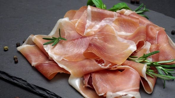 Thumbnail for Sliced Prosciutto or Jamon Meat on Concrete Background