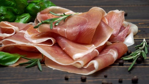 Cover Image for Sliced Prosciutto or Jamon Meat on Wooden Background
