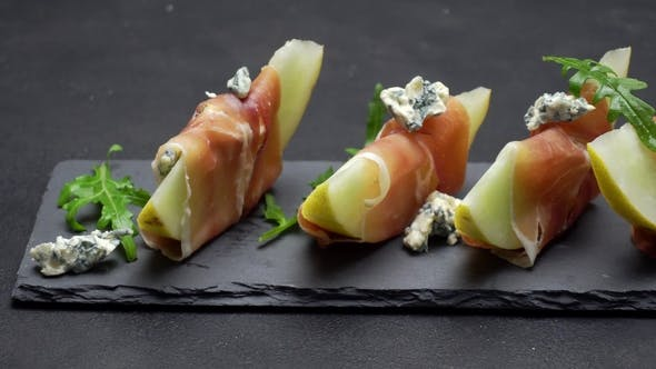 Thumbnail for Sliced Prosciutto and Melon on a Stone Board