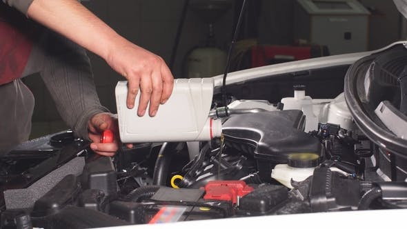 Thumbnail for Pouring Oil To Car Engine, .