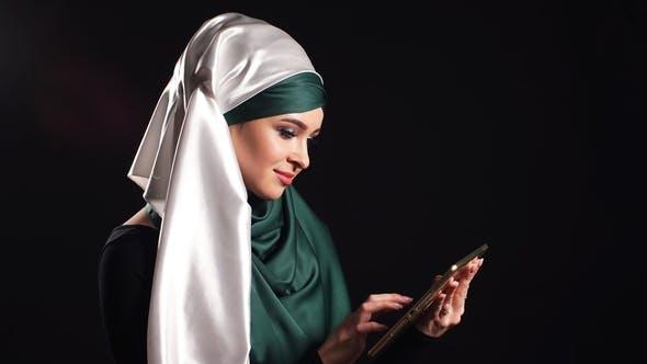 Thumbnail for Portrait of Beautiful Arabic Muslim Girl Using Mobile Phone.