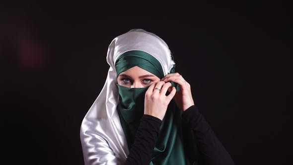 Thumbnail for Portrait of an Attractive Young Modern Muslim Woman in Hijab.