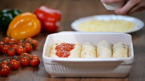 Thumbnail for Homemade Chicken Enchiladas in Dish