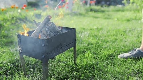 Man Adds Liquid Ignition To the Small Smoking Wood in the Grill and Flame Bursts Out, BBQ at the