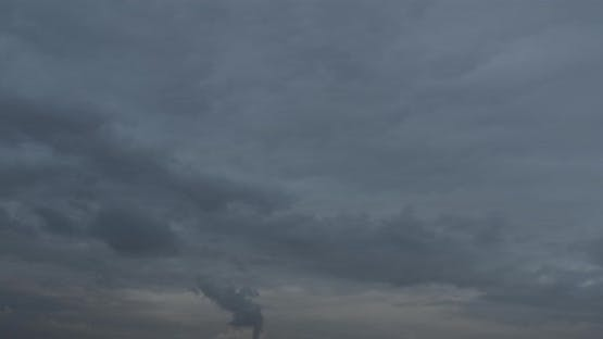 Thick Smoke From The Factory Chimney Pollutes The Environment