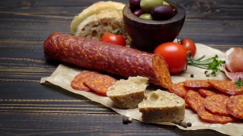 Salami or Chorizo Sausage  on a Wood Board