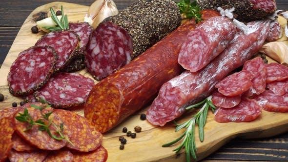 Salami and Chorizo Sausage  on Wooden Background
