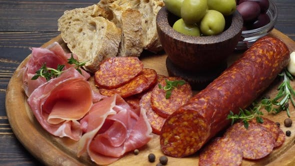 Thumbnail for Sliced Prosciutto and Salami Sausage on a Wooden Board
