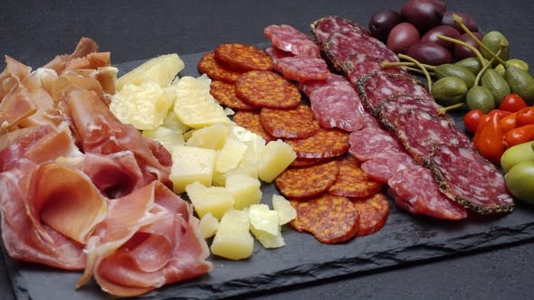 Thumbnail for Sliced Prosciutto, Cheese and Salami Sausage on Stone Serving Board