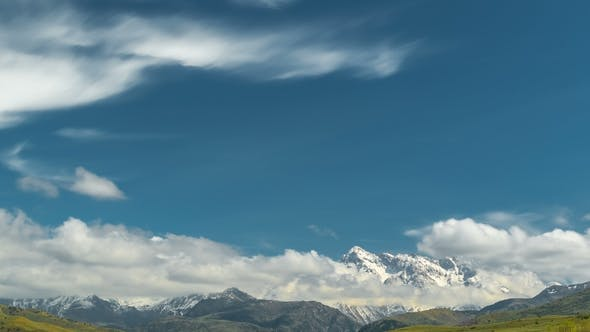 Cover Image for Scenery with Mountain Peaks and Cloudy Sky