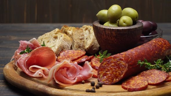 Cover Image for Sliced Prosciutto and Salami Sausage on a Wooden Board