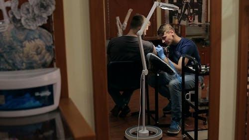 Tattoo Artist Makes Tattoo of Man in Tattoo Parlor