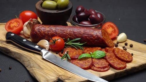 Salami and Chorizo Sausage  on Dark Concrete Background