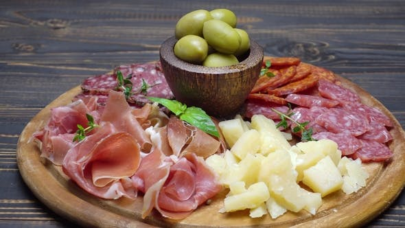 Cover Image for Sliced Prosciutto, Cheese and Salami Sausage on a Wooden Board