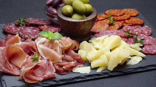 Cover Image for Sliced Prosciutto, Cheese and Salami Sausage on Stone Serving Board