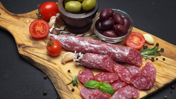 Cover Image for Salami and Chorizo Sausage  on Dark Concrete Background