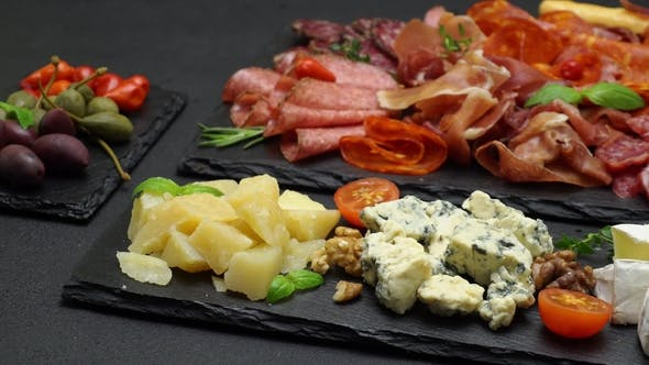 Cover Image for Various Types of Italian Food - Cheese, Sausage and Tomatoes