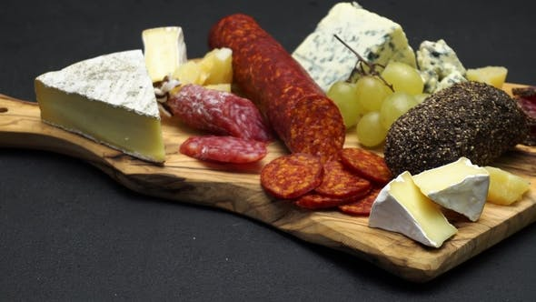 Thumbnail for Salami, Chorizo Sausage and Cheese  on Dark Concrete Background