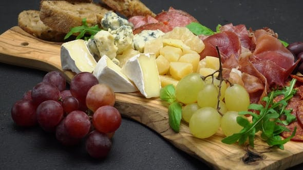 Thumbnail for Meat and Cheese Plate Antipasti Snack with Prosciutto, Melon, Grapes and Cheese